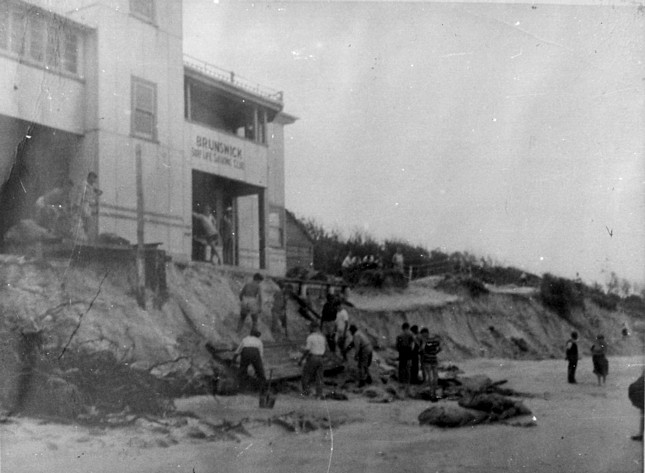 Surf Life Savers Clubhouse Brunswick Heads undermined by a cyclone circa 1950